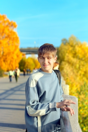 smiling teenager standing on the street photo