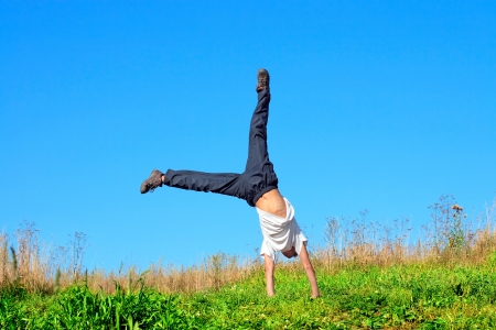 somersault: somersault on the summer meadow Stock Photo