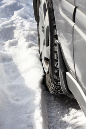 car wheel in snow closeup photo