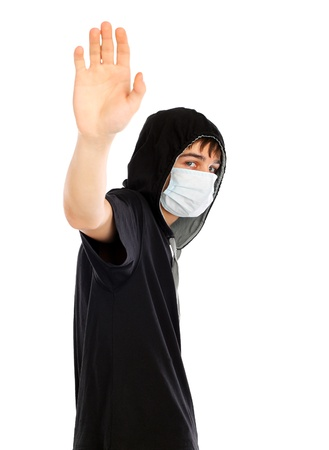 teenager in the flu mask wave goodbye  isolated on white background photo