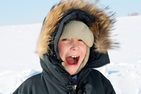 Portrait of Screaming Boy in the Winter photo