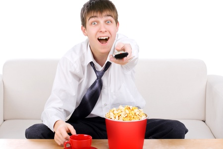 Happy Teenager with Remote Control and Popcorn photo