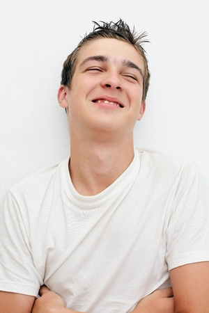 Satisfied Young Man on the White Wall background photo