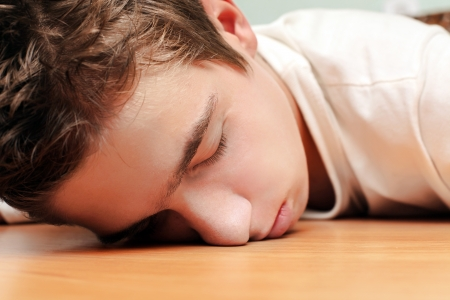 Young Man Sleeping on the Table in Home inerior photo