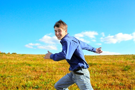 Happy Teenager Running Fast in the Autumn Field Stock Photo - 16762974