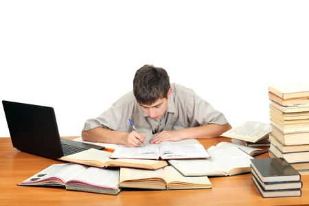 Student on the School Desk is Writing Stock Photo - 16763110