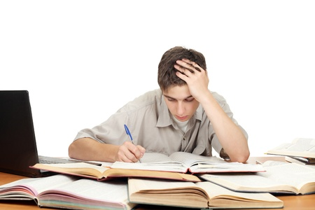 Student on the School Desk is Writing Stock Photo - 16763104