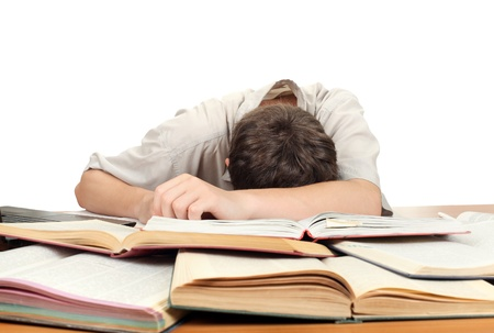 Tired Teenager lying and sleeping on the School Desk Stock Photo - 16763105
