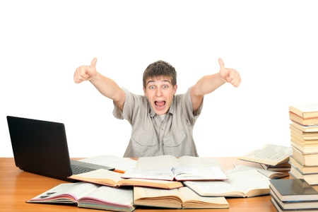 Happy Student on the School Desk shows OK gesture  Isolated on the White Background Stock Photo - 16763070