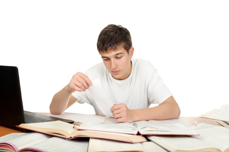Teenage Student working on the School Desk  Isolated on the White Background Stock Photo - 16907932