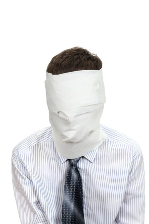 Man in shirt and necktie wrapped his face in a paper  Isolated on the White Background photo