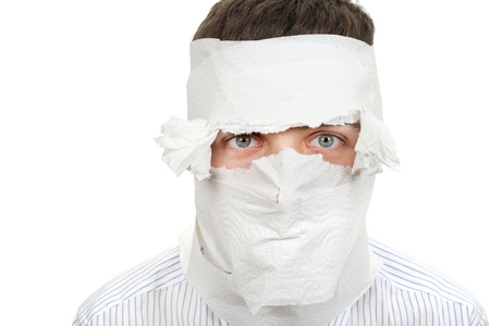 Man in shirt and necktie wrapped his face in a paper  Isolated on the White Background Stock Photo - 16908032