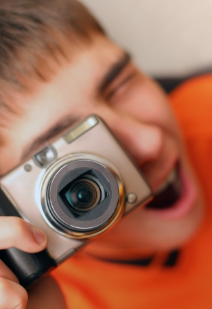 Excited Teenager with Photocamera gets ready to take a photograph Stock Photo - 17283059