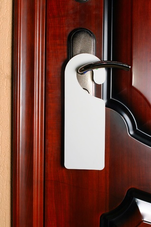 Empty white label on a brown new door closeup Stock Photo - 17902089