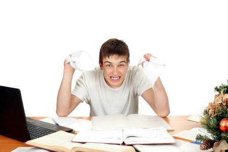 rampage: Angry Student with rumpled papers in his hands  Isolated on the white background