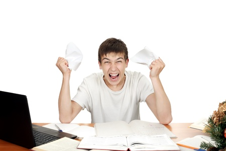 exasperation: Furious Student with jammed papers in his fists  Isolated on the white background