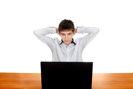 settle back: Young Man with Laptop at the Desk  Isolated on the white background