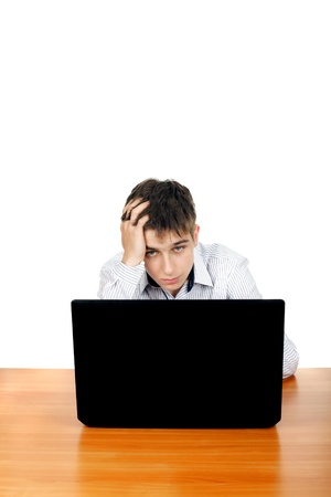 Sad and Troubled Teenager with Laptop  Isolated on the White Background Stock Photo - 17796654