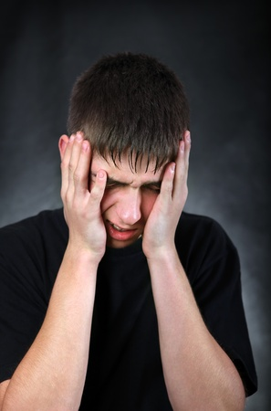 Portrait of Painful Young Man on the Black Background Stock Photo - 18058826