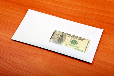 Envelope With Money lying on the table photo