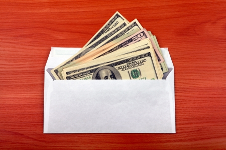 payola: Envelope With Money lying on the table