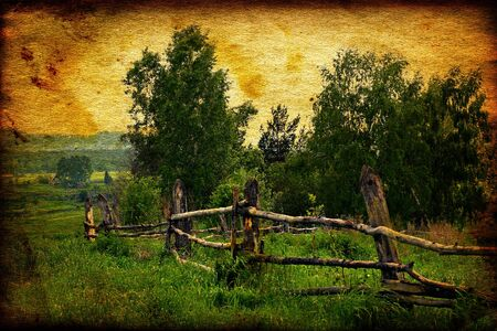 Vintage Photo Landscape of Countryside with Old Fence in Foreground photo