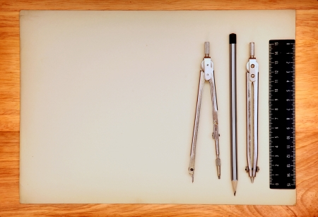 Blank Paper and Drawing Tools on the Wooden Background photo