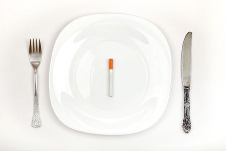 deleterious: Concept of Cigarette on a Dinner Plate Instead a Food Stock Photo