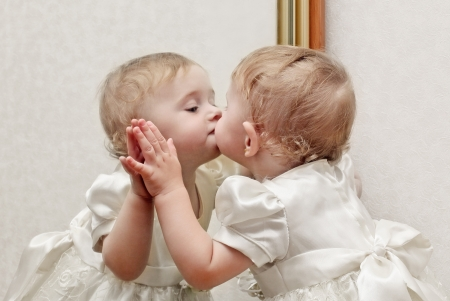 kissing lips: Cute Baby Kissing a Mirror with oneself Reflection