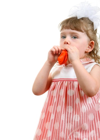 to inflate: Little Girl Try to inflate a Balloon  Isolated on the white background Stock Photo
