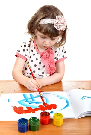 Cute Little Girl Drawing Isolated on the white background photo