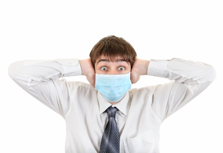 Shocked Young Man in Flu Mask Covering his Ears  Isolated on the White Background photo
