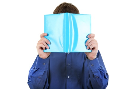 hides: The person hides the face behind the book  Isolated on the White Background Stock Photo