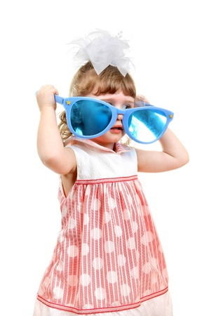 Cheerful Little Girl with Big Blus Glasses Isolated on the White Background photo