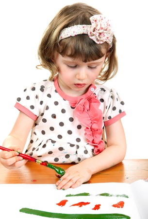 Little Girl Drawing at the nursery class  On the white Background photo