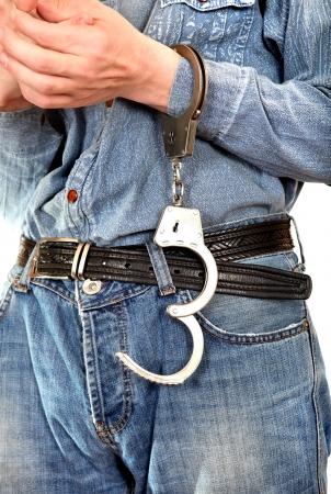 culprit: Man with Unlocked Handcuffs on a Hand Stock Photo