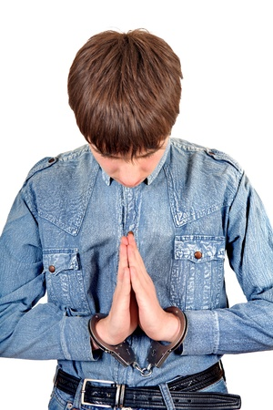 Praying Man in Handcuffs Isolated on the White Background photo