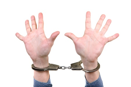 Handcuffs on Hands with wide apart fingers  Isolated on the White Background