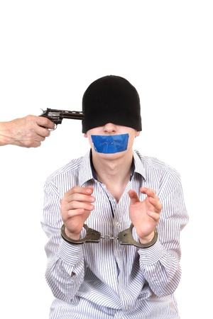 Hostage in Handcuffs with Sealed Mouth Isolated on the White Background