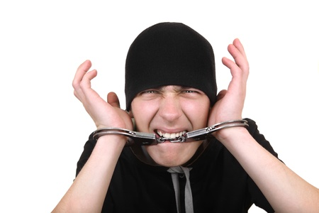 malefactor: Angry Man Gnaw his Handcuffs Isolated on the White Background