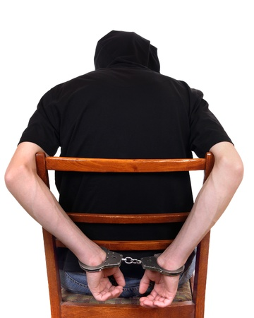 metal handcuffs: Man on the chair in Handcuffs  Rear view and Closeup
