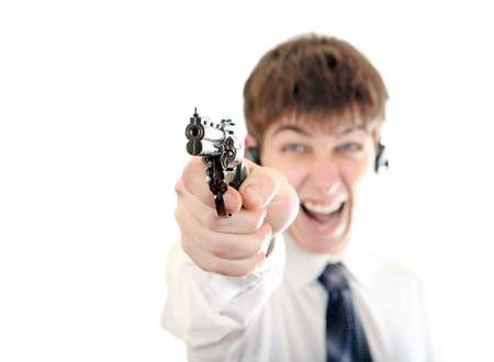 angriness: Angry Teenager with a Pistol on the White Background