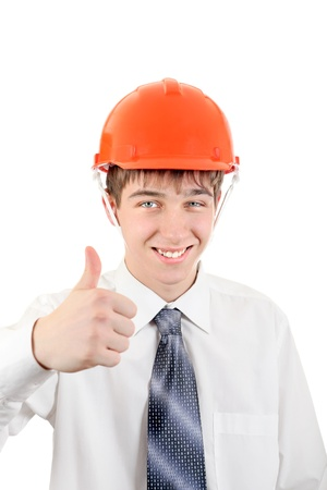 Happy Young Man in Hard Hat showing thumb up Isolated on the white Background Stock Photo - 21622574
