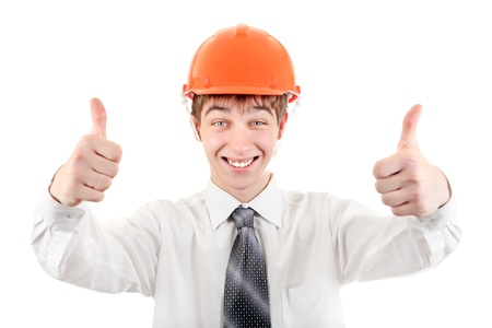 Happy Young Man in Hard Hat showing thumb up Isolated on the white Background Stock Photo - 21622576