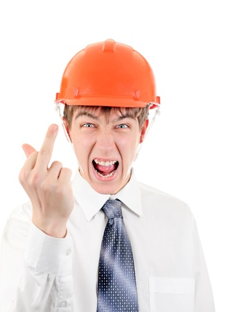 angriness: Extremely Angry Young Man in Hard Hat showing Middle Finger gesture
