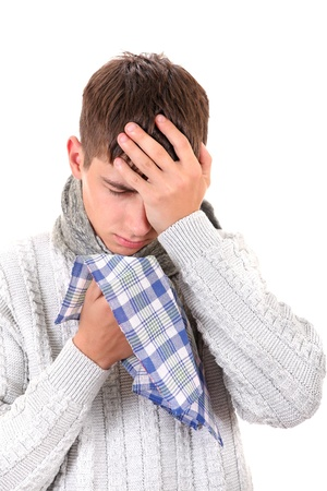 Diseased Young Man in sweater with handkerchief  Isolated on the White Background Stock Photo - 21827112