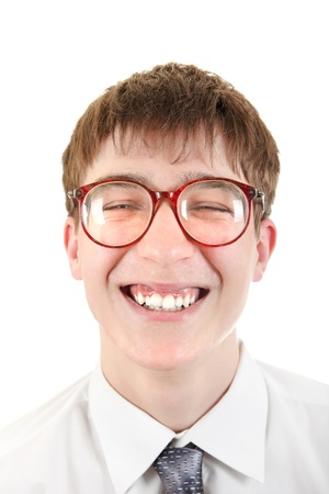 dweeb: Happy and Funny Teenager portrait in a Glasses  Isolated on the White Background Stock Photo