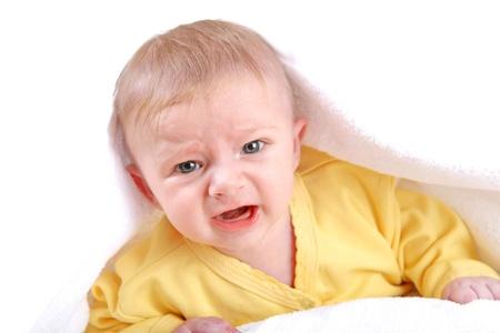 Sad Baby Boy lying on the White blanket and Crying Stock Photo - 21822701