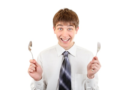 Happy Teenager with Cutlery  Isolated on the White Background photo
