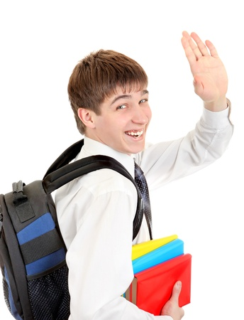 gladden: Happy Student with Knapsack and the Books Wave Goodbye  Isolated on the White Background Stock Photo
